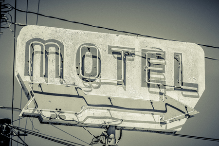 Old, vintage, flaking, motel sign with an arrow 写真素材