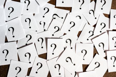 A group of printed question marks on paper