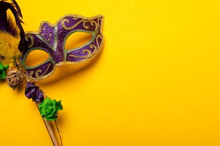 Colorful Mardi Gras mas on a yellow background