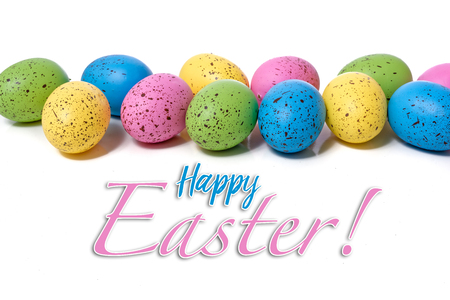 Colorful speckled easter eggs on a white background with greeting