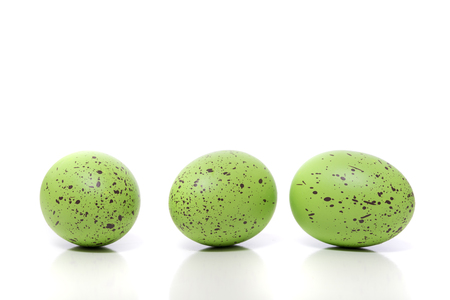 A group of green Easter Eggs with speckles on a white background 写真素材