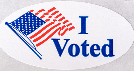 An I Voted sticker with US flag on a white background