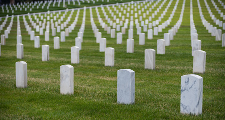 Hundreds of white grave markers at a national cemetary