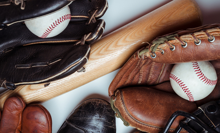A group of vintage baseball equipment on a white background Imagens