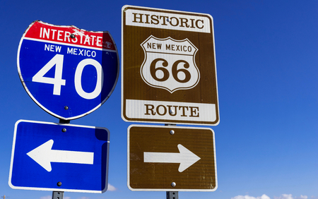 a group of Highway markers on historic highway 66 and interstate 40 in the American southwest 版權商用圖片
