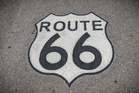 The famous route 66 highway shield painted on the road