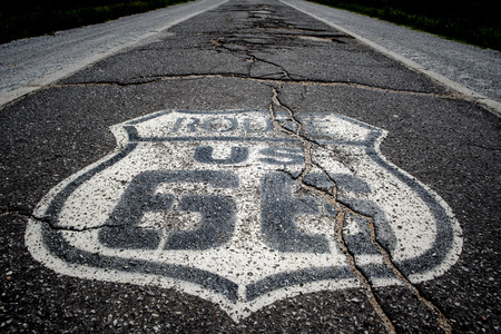 The famous route 66 highway shield painted on ta histroic stretch of single lane highway dating from the 1920s