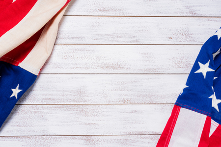 A set of American flags on a white slat wood background with copy space