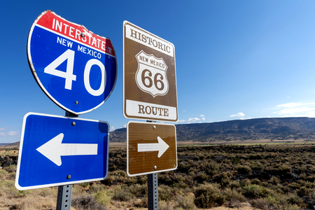 a group of Highway markers on historic highway 66 and interstate 40 in the American southwest Фото со стока
