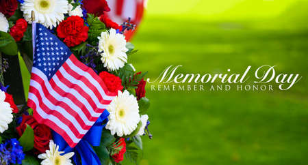 A beautiful wreath of flowers and a flag on Memorial Day