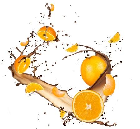 orange splash: Oranges in chocolate splash, isolated on white background
