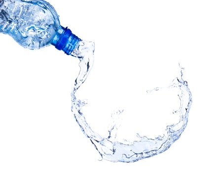 Fresh water splashing out of bottle, isolated on white background  photo