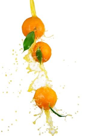 Fresh oranges with juice splash, isolated on white background  photo