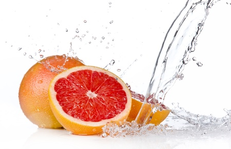 Fresh grapefruit slice in water splash, isolated on white background Stock Photo