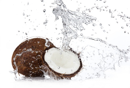 Fresh coconuts in water splash, isolated on white background photo