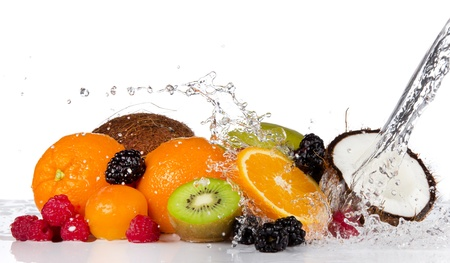 Fresh fruits pieces in water splash, isolated on white background photo