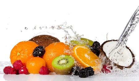 splash mixed: Fresh fruits pieces in water splash, isolated on white background Stock Photo