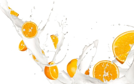 refrigerant: Oranges in milk splash, isolated on white background Stock Photo