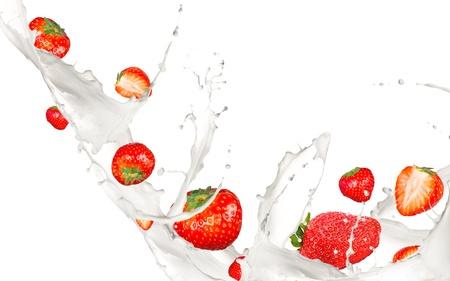Strawberries in milk splash, isolated on white background photo