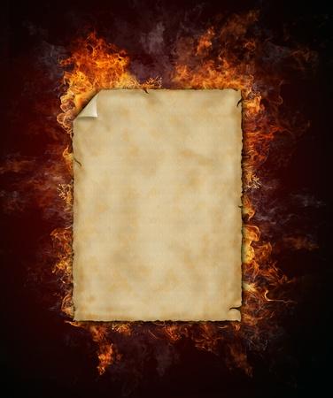 burning paper: Burning empty grunge paper on black background Stock Photo