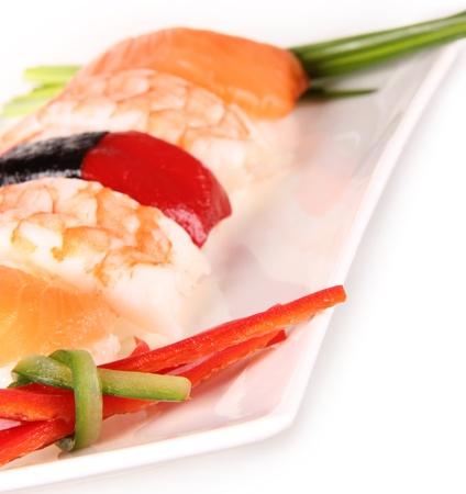 Sushi pieces on white background photo