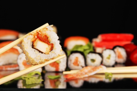 Sushi food, isolated on black background photo