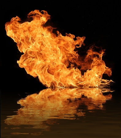 Fire flame with water reflection photo