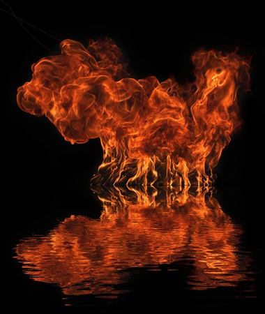Big fire flame with water reflection photo