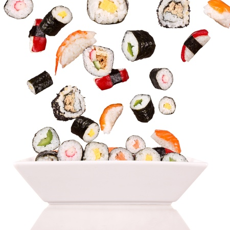 sushi plate: Delicious pieces of sushi, isolated on white background Stock Photo