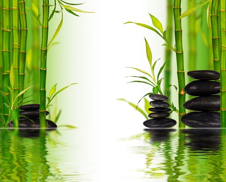 Spa bamboo background and lava stones with water surface