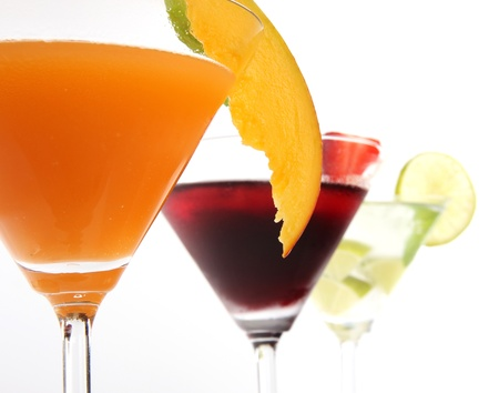 Tropical Martini drinks with fruits on white background photo