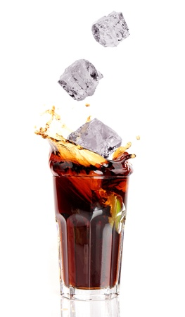 coctail: Glass of cola splashing, isolated on white background