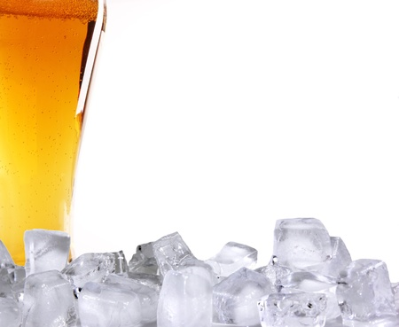 Beer glass with ice cubes  photo