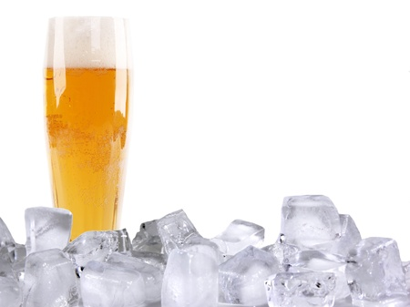 Glass of beer with ice cubes, isolated on white background photo