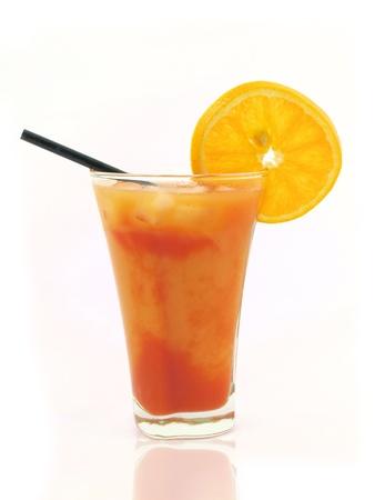 Orange drink on white background photo