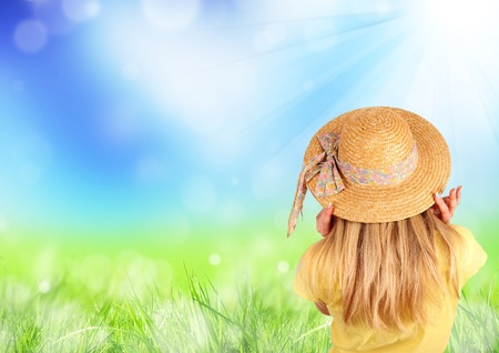 Spring meadow with blond girl back portrait photo