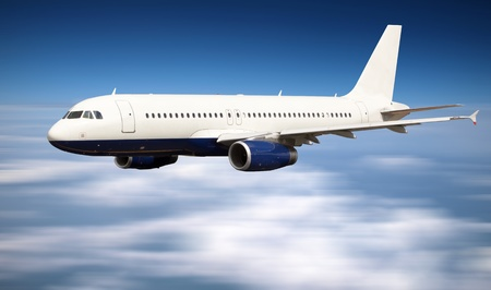corporate airplane: Big jet plane flying above clouds
