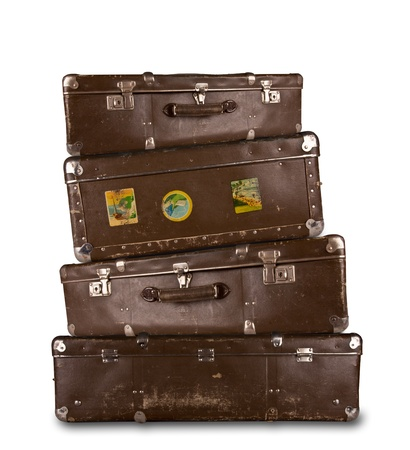 best travel destinations: Pile of retro suitcases, isolated on white background