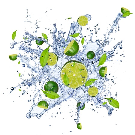 soda splash: Limes pieces falling in water splash, isolated on white background  Stock Photo
