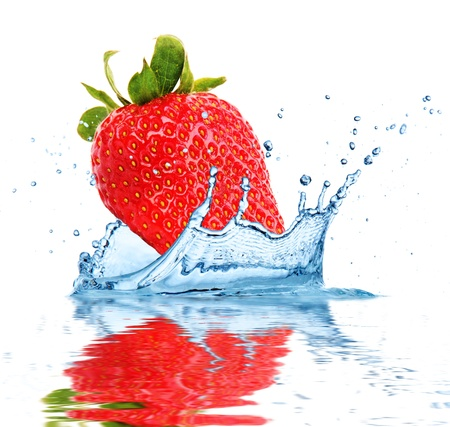 Strawberry falling into water, isolated on white background photo