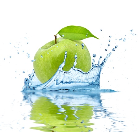 Green apple falling into water, isolated on white background photo