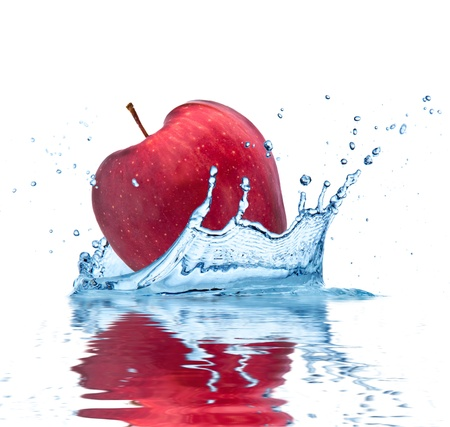Red apple falling into water, isolated on white background photo