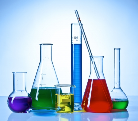 Chemical glasswares with colored liquids inside bottles photo