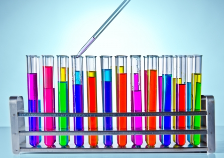yellow yellow lab: Laboratory test tubes with pippet Stock Photo