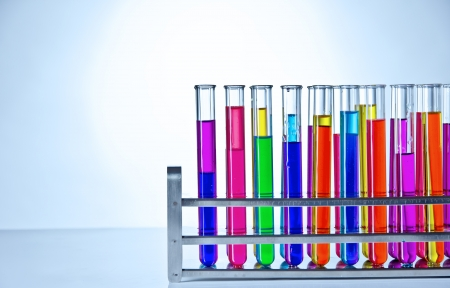 Laboratory test tubes with colored liquids inside photo