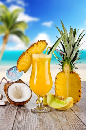 colada: Pina colada drink with blur beach on background