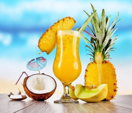 pineapple  glass: Pina colada drink with blur beach on background