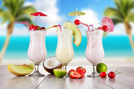Pina colada drinks with blur beach on background photo