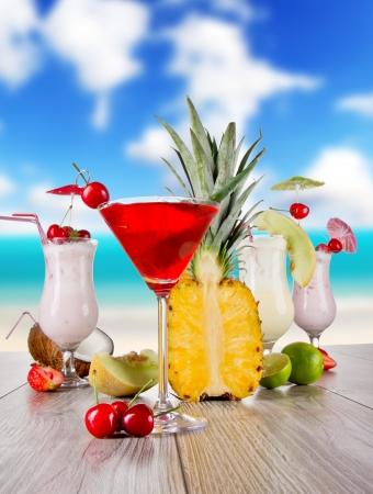 carribean: Summer drinks with blur beach on background