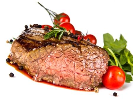 medium close up: Beef steak medium grilled, isolated on white background